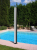 Solar showers for swimming pools